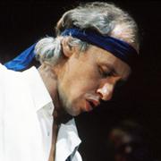 Mark Knopfler of Dire Straits.  ©†Michael Putland / Retna Ltd.